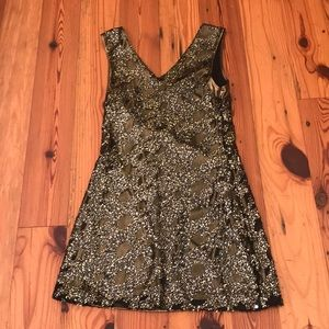 Beautiful sequined dress or top with leggings